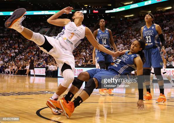 Diana Taurasi of the Phoenix Mercury collides with Maya Moore of the Minnesota Lynx during the second half of game three of the WNBA Western...