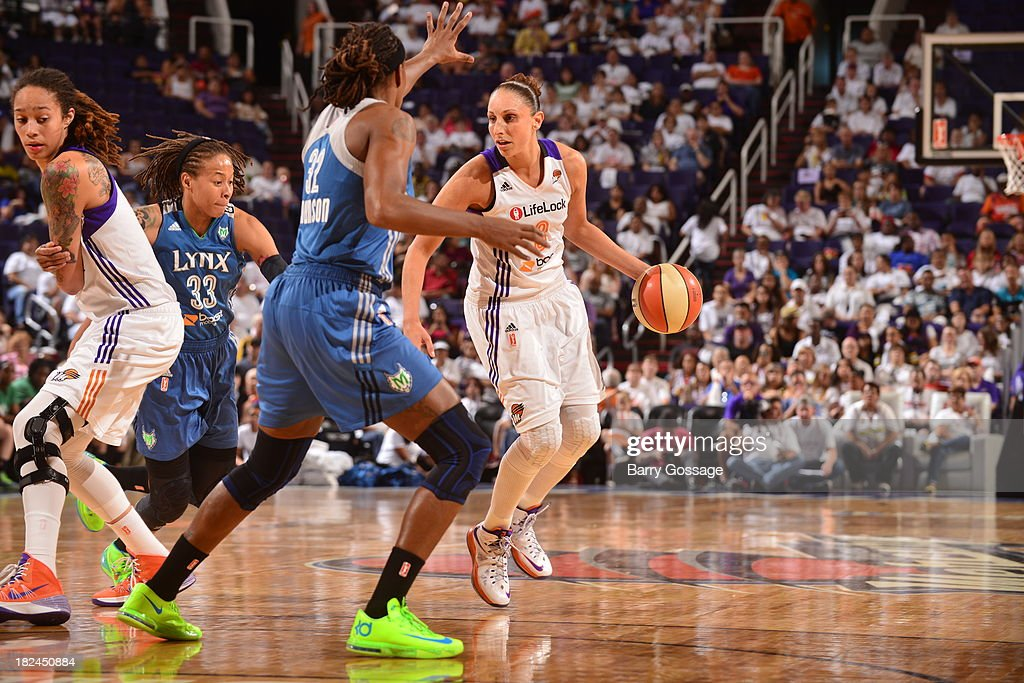 <a gi-track='captionPersonalityLinkClicked' href=/galleries/search?phrase=Diana+Taurasi&family=editorial&specificpeople=202558 ng-click='$event.stopPropagation()'>Diana Taurasi</a> #3 of the Phoenix Mercury dribbles against <a gi-track='captionPersonalityLinkClicked' href=/galleries/search?phrase=Seimone+Augustus&family=editorial&specificpeople=540457 ng-click='$event.stopPropagation()'>Seimone Augustus</a> #33 of the Minnesota Lynx in Game 2 of the Western Conference Finals during 2013 WNBA Playoffs on September 29, 2013 at U.S. Airways Center in Phoenix, Arizona.