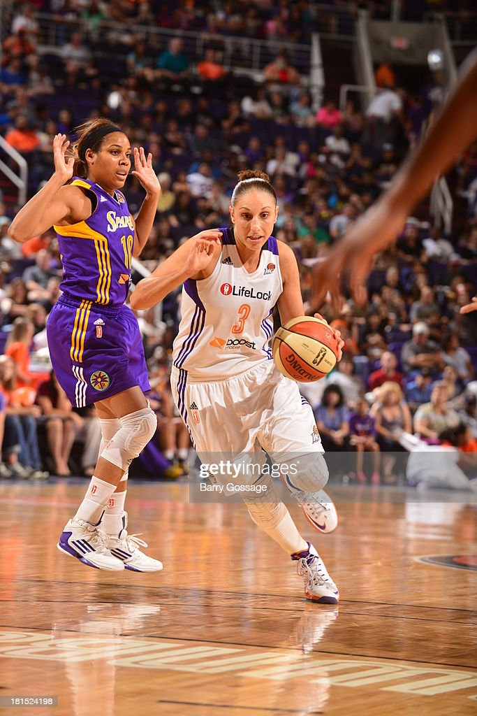 <a gi-track='captionPersonalityLinkClicked' href=/galleries/search?phrase=Diana+Taurasi&family=editorial&specificpeople=202558 ng-click='$event.stopPropagation()'>Diana Taurasi</a> #3 of the Phoenix Mercury drives against <a gi-track='captionPersonalityLinkClicked' href=/galleries/search?phrase=Lindsey+Harding&family=editorial&specificpeople=704302 ng-click='$event.stopPropagation()'>Lindsey Harding</a> #10 of the Los Angeles Sparks in Game 2 Round 1 of the 2013 WNBA Playoffs on September 13, 2013 at U.S. Airways Center in Phoenix, Arizona.