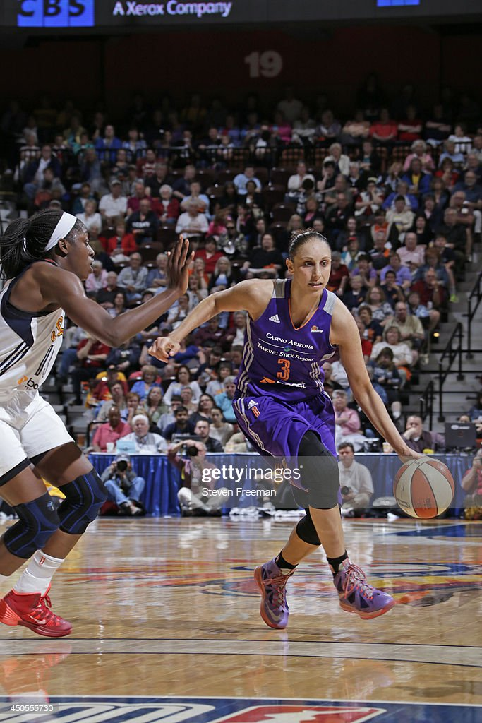 <a gi-track='captionPersonalityLinkClicked' href=/galleries/search?phrase=Diana+Taurasi&family=editorial&specificpeople=202558 ng-click='$event.stopPropagation()'>Diana Taurasi</a> #3 of the Phoenix Mercury drives to the basket against the Connecticut Sun on June 12, 2014 at Mohegan Sun Arena in Uncasville, Connecticut.