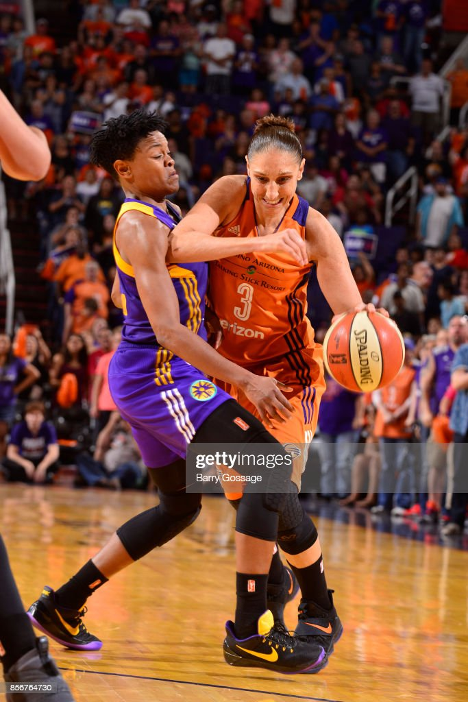 Diana Taurasi #3 of the Phoenix Mercury handles the ball against Alana Beard #0 of the Los Angeles Sparks in Game Three of the Semifinals during the 2017 WNBA Playoffs on September 17, 2017 at Talking Stick Resort Arena in Phoenix, Arizona.