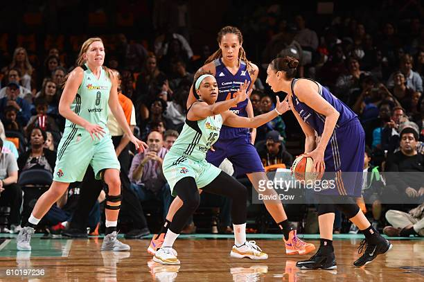 Diana Taurasi of the Phoenix Mercury handles the ball against Brittany Boyd of the New York Liberty during Round Two of the 2016 WNBA Playoffs on...