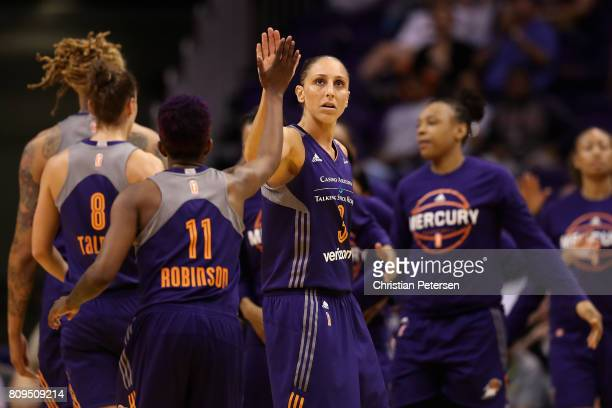 Diana Taurasi of the Phoenix Mercury high fives Danielle Robinson after scoring against the Washington Mystics during the second half of the WNBA...
