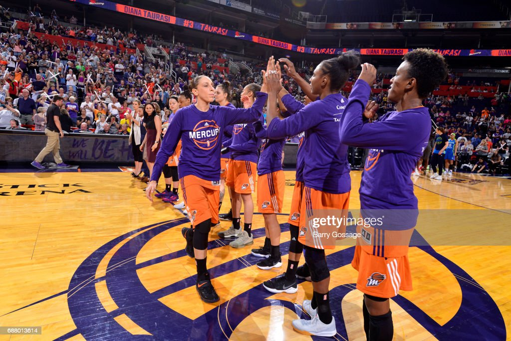 Diana Taurasi #3 of the Phoenix Mercury high fives her teammates before the game against the Dallas Wings on May 14, 2017 at Talking Stick Resort Arena in Phoenix, Arizona.
