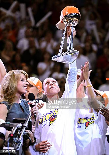 Diana Taurasi of the Phoenix Mercury holds up the WNBA trophy in celebration after defeating the Indiana Fever in Game Five of the 2009 WNBA Finals...