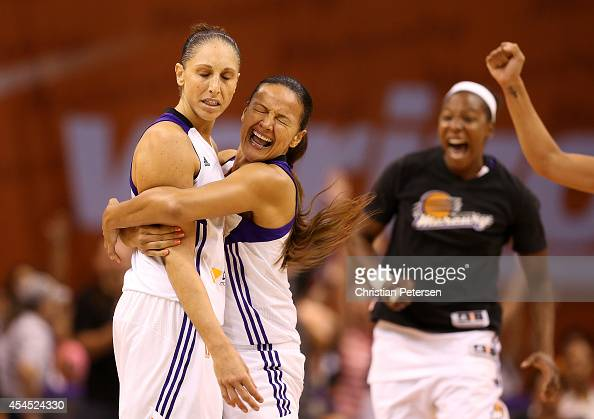 Diana Taurasi of the Phoenix Mercury is congratulated by Mistie Bass after Taurasi hit a half court shot at the end of the third quarter during game...