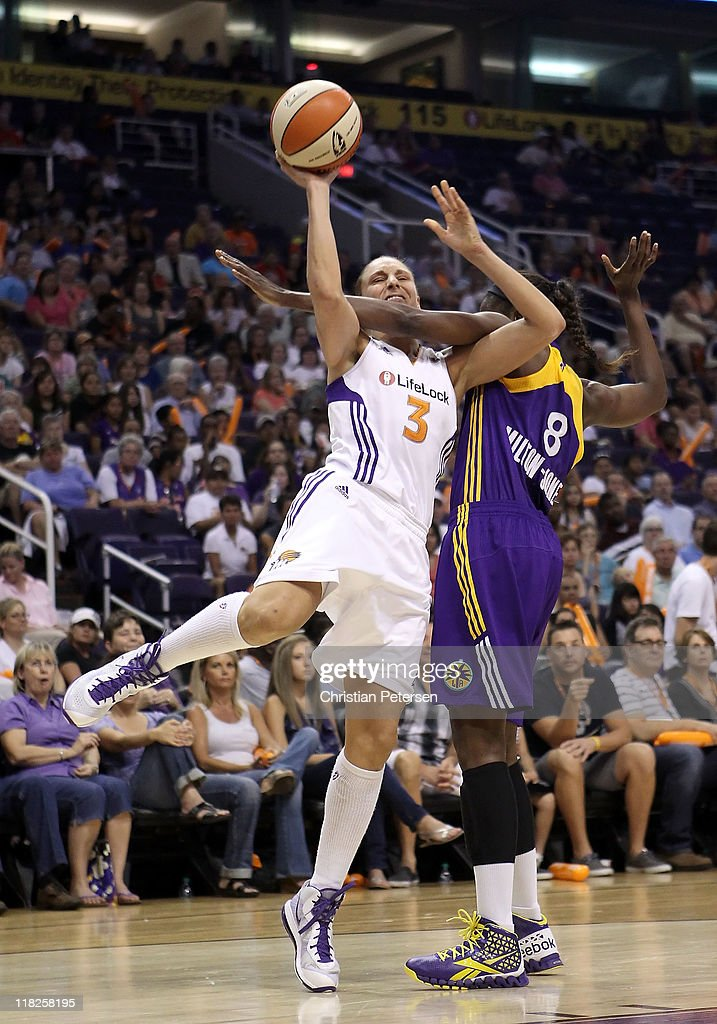 Diana Taurasi of the Phoenix Mercury is fouled by DeLisha MiltonJones of the Los Angeles Sparks as she attempts a shot during the WNBA game at US...