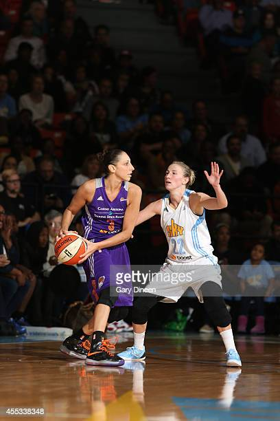 Diana Taurasi of the Phoenix Mercury passes against Courtney Vandersloot of the Chicago Sky in Game Three of the 2014 WNBA Finals on September 12...