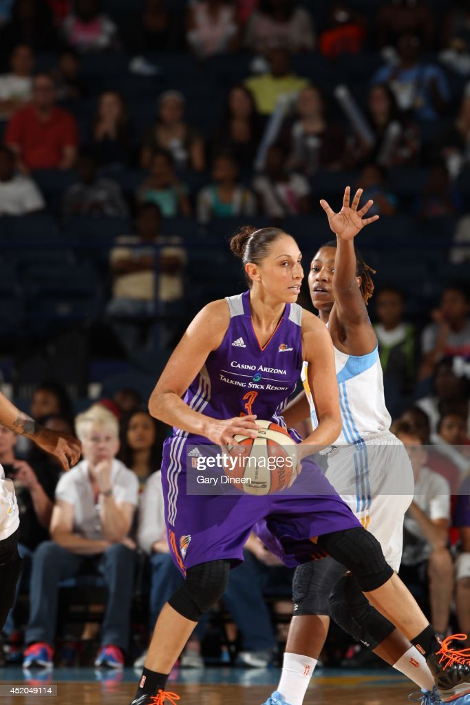 <a gi-track='captionPersonalityLinkClicked' href=/galleries/search?phrase=Diana+Taurasi&family=editorial&specificpeople=202558 ng-click='$event.stopPropagation()'>Diana Taurasi</a> #3 of the Phoenix Mercury passes the ball against the Chicago Sky on July 11, 2014 at the Allstate Arena in Rosemont, Illinois.