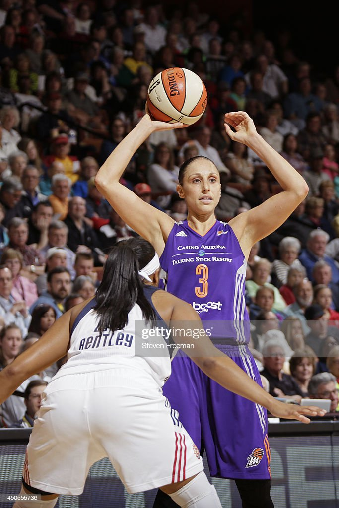 <a gi-track='captionPersonalityLinkClicked' href=/galleries/search?phrase=Diana+Taurasi&family=editorial&specificpeople=202558 ng-click='$event.stopPropagation()'>Diana Taurasi</a> #3 of the Phoenix Mercury passes the ball against the Connecticut Sun on June 12, 2014 at Mohegan Sun Arena in Uncasville, Connecticut.