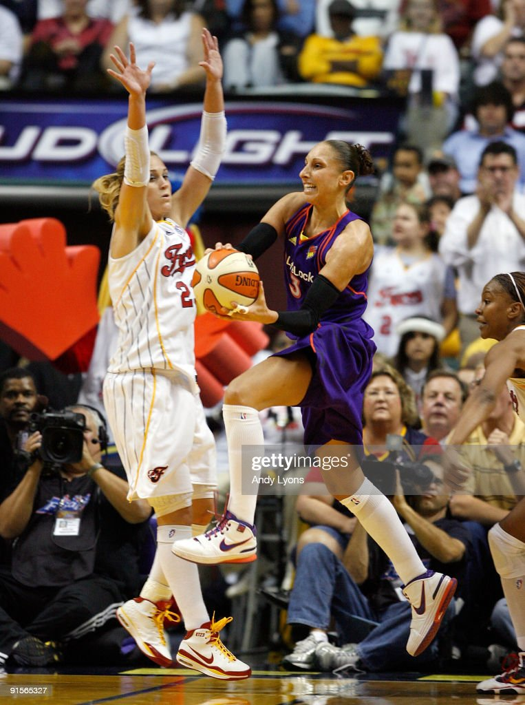 Diana Taurasi of the Phoenix Mercury passes the ball while defended by Katie Douglas of the Indiana Fever during the WNBA Finals game 4 at Conseco...
