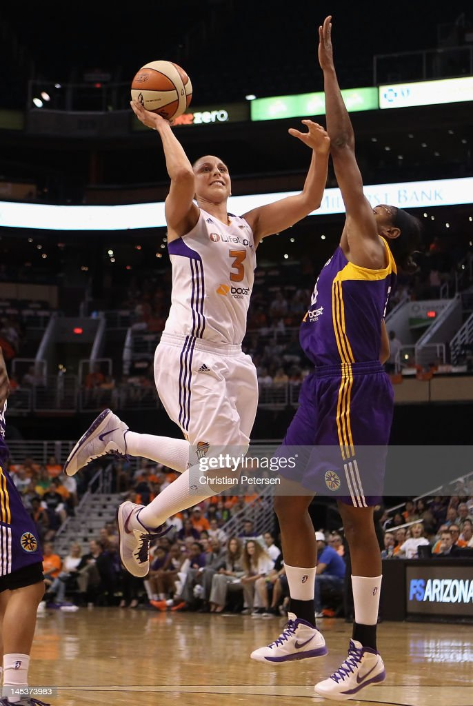 Diana Taurasi of the Phoenix Mercury puts up a shot against the Los Angeles Sparks during the WNBA game at US Airways Center on May 26 2012 in...