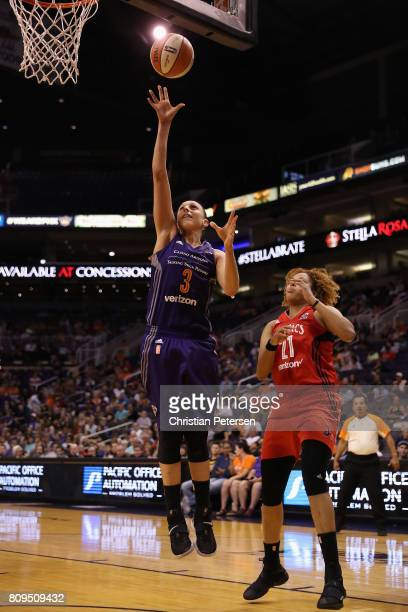 Diana Taurasi of the Phoenix Mercury puts up a shot ahead of Tianna Hawkins of the Washington Mystics during the second half of the WNBA game at...