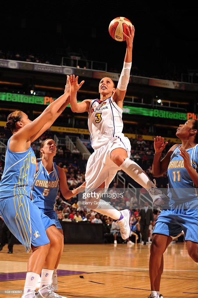 Diana Taurasi of the Phoenix Mercury shoots against Mistie Bass and Jia Perkins of the Chicago Sky on August 1 2010 at US Airways Center in Phoenix...