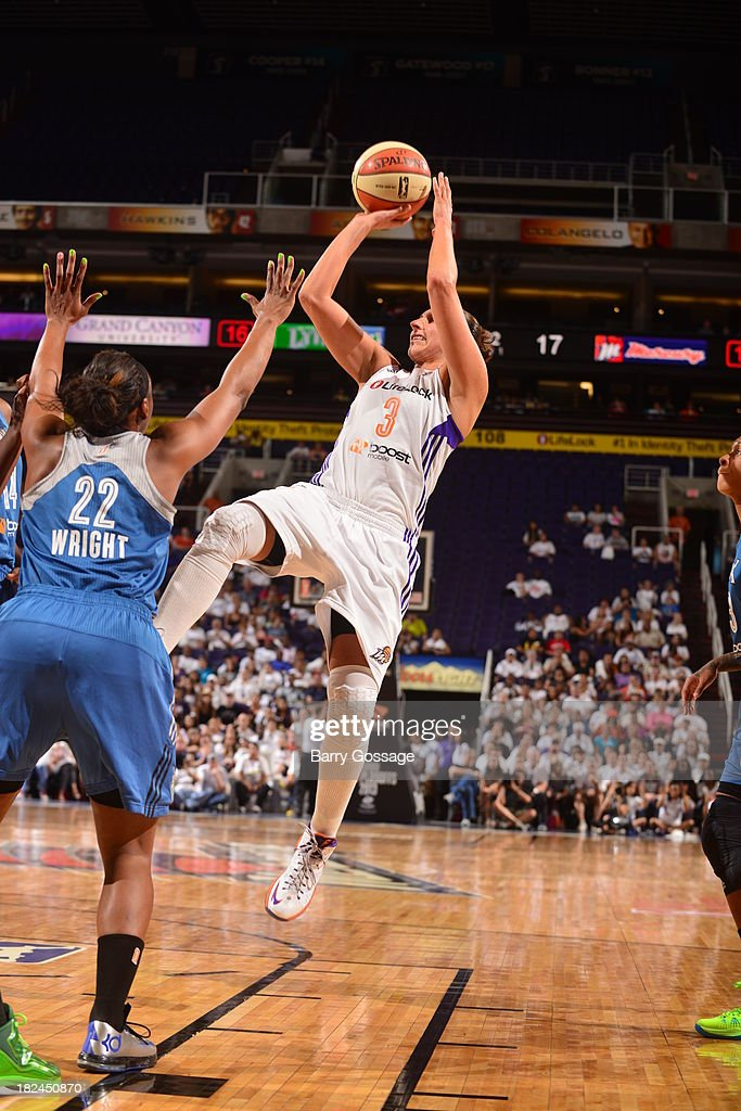<a gi-track='captionPersonalityLinkClicked' href=/galleries/search?phrase=Diana+Taurasi&family=editorial&specificpeople=202558 ng-click='$event.stopPropagation()'>Diana Taurasi</a> #3 of the Phoenix Mercury shoots against Monica Wright #22 of the Minnesota Lynx in Game 2 of the Western Conference Finals during 2013 WNBA Playoffs on September 29, 2013 at U.S. Airways Center in Phoenix, Arizona.
