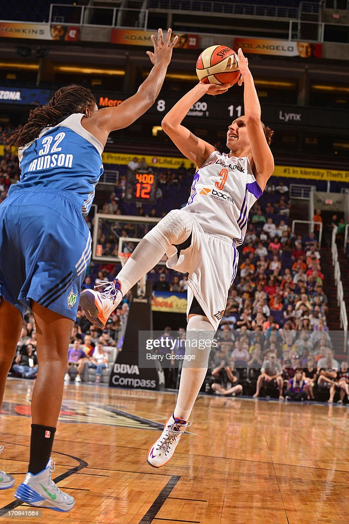 <a gi-track='captionPersonalityLinkClicked' href=/galleries/search?phrase=Diana+Taurasi&family=editorial&specificpeople=202558 ng-click='$event.stopPropagation()'>Diana Taurasi</a> #3 of the Phoenix Mercury shoots against <a gi-track='captionPersonalityLinkClicked' href=/galleries/search?phrase=Rebekkah+Brunson&family=editorial&specificpeople=213521 ng-click='$event.stopPropagation()'>Rebekkah Brunson</a> #32 of the Minnesota Lynx on June 19, 2013 at U.S. Airways Center in Phoenix, Arizona.