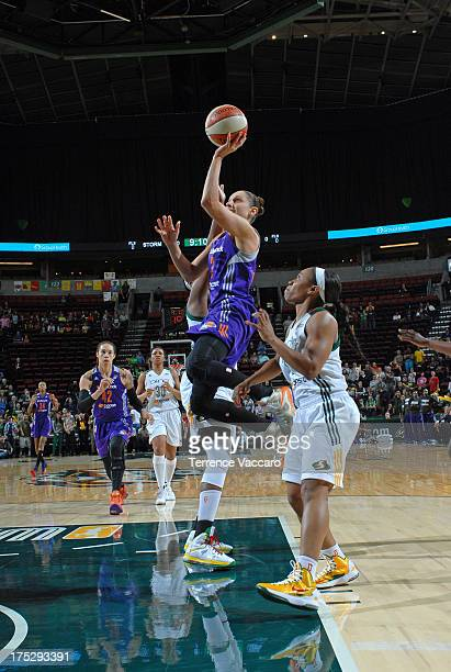 Diana Taurasi of the Phoenix Mercury shoots against Temeka Johnson of the Seattle Storm during the game on August 1 2013 at Key Arena in Seattle...