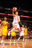 Diana Taurasi of the Phoenix Mercury shoots against Tina Thompson of the Los Angeles Sparks in Game Two of the WNBA Western Conference Finals played...
