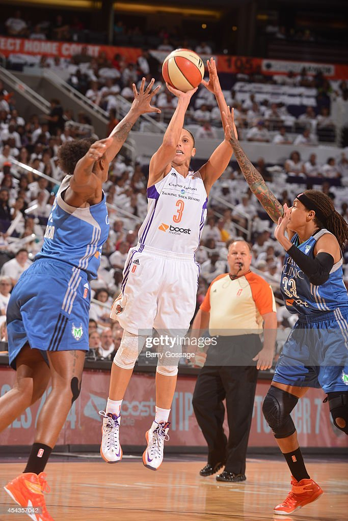 Diana Taurasi #3 of the Phoenix Mercury shoots the ball against Seimone Augustus #33 of the Minnesota Lynx in Game 1 of the 2014 WNBA Western Conference Finals on August 29, 2014 at US Airways Center in Phoenix, Arizona.