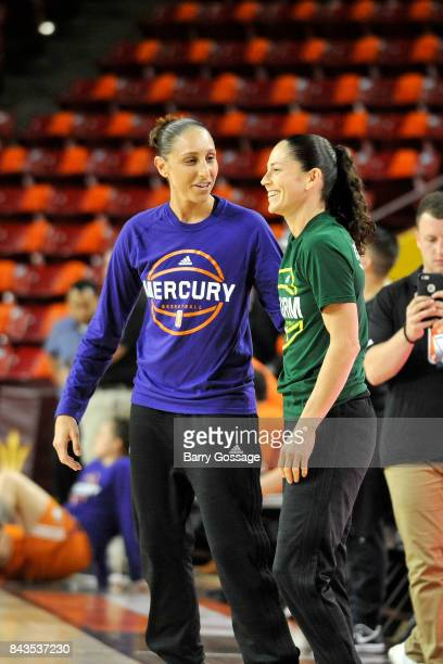 Diana Taurasi of the Phoenix Mercury talks with Sue Bird of the Seattle Storm before the game in Round One of the 2017 WNBA Playoffs on September 6...