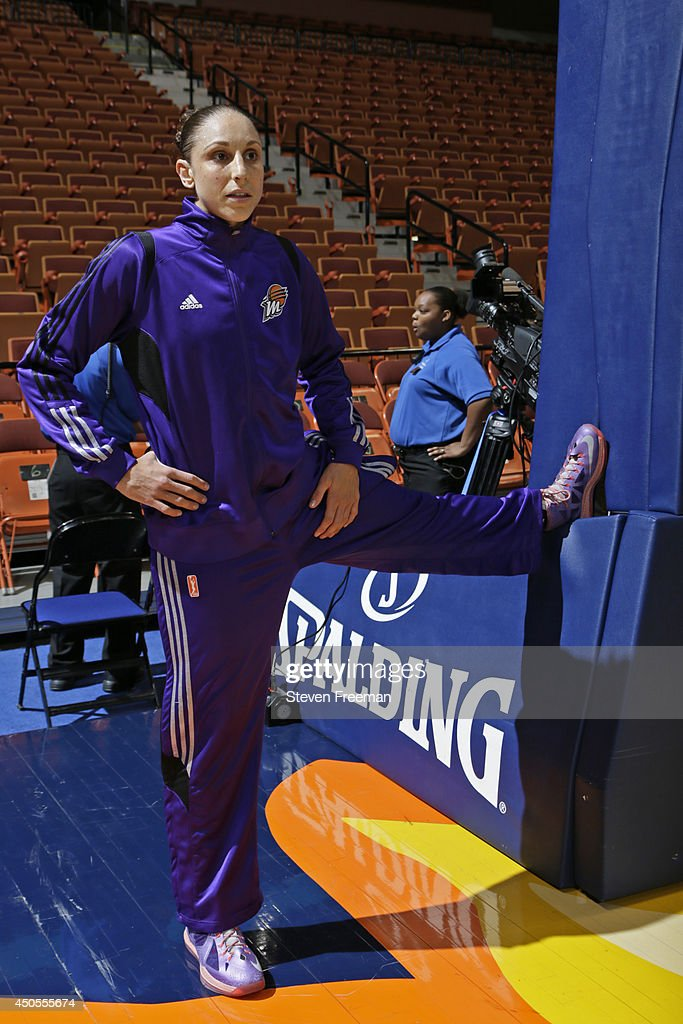 <a gi-track='captionPersonalityLinkClicked' href=/galleries/search?phrase=Diana+Taurasi&family=editorial&specificpeople=202558 ng-click='$event.stopPropagation()'>Diana Taurasi</a> #3 of the Phoenix Mercury warms up before the game against the Connecticut Sun on June 12, 2014 at Mohegan Sun Arena in Uncasville, Connecticut.