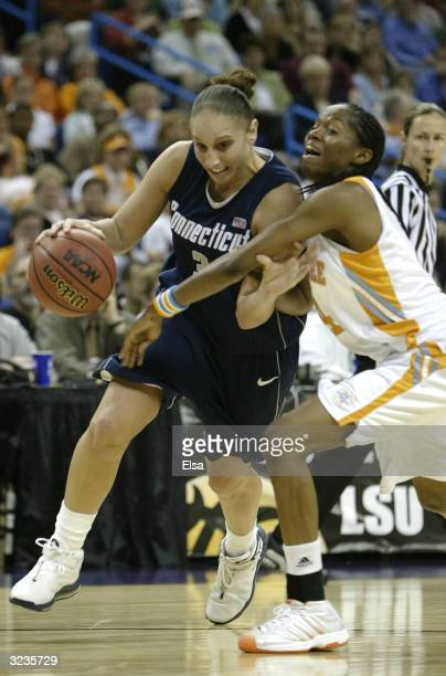 Diana Taurasi of the University of Connecticut Huskies dribbles against the defense of LaToya Davis of the Tennessee Lady Vols during the National...