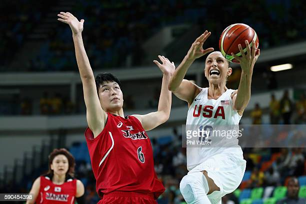 Diana Taurasi of United States drives to the basket against Yuka Mamiya of Japan during the Women's Quarterfinal match on Day 11 of the Rio 2016...
