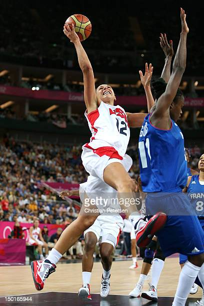 Diana Taurasi of United States goes up for a shot against Emilie Gomis of France in the first half during the Women's Basketball Gold Medal game on...