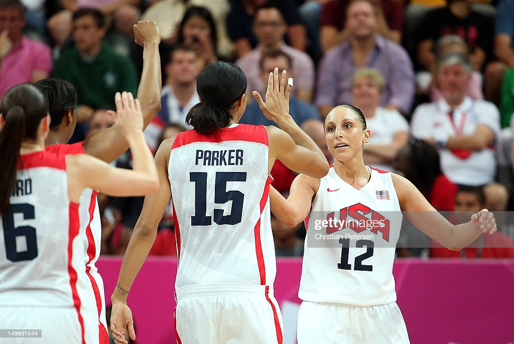 <a gi-track='captionPersonalityLinkClicked' href=/galleries/search?phrase=Diana+Taurasi&family=editorial&specificpeople=202558 ng-click='$event.stopPropagation()'>Diana Taurasi</a> #12 (R) of United States high-fives <a gi-track='captionPersonalityLinkClicked' href=/galleries/search?phrase=Candace+Parker&family=editorial&specificpeople=752955 ng-click='$event.stopPropagation()'>Candace Parker</a> #15 after scoring against Canada during the Women's Basketball quaterfinal on Day 11 of the London 2012 Olympic Games at the Basketball Arena on August 7, 2012 in London, England.