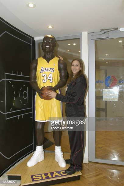 Diana Taurasi poses with a Shaquille O'Neal lifesize bobblehead during a visit to ESPN the Magazine in New York City on April 15 2004 before the WNBA...