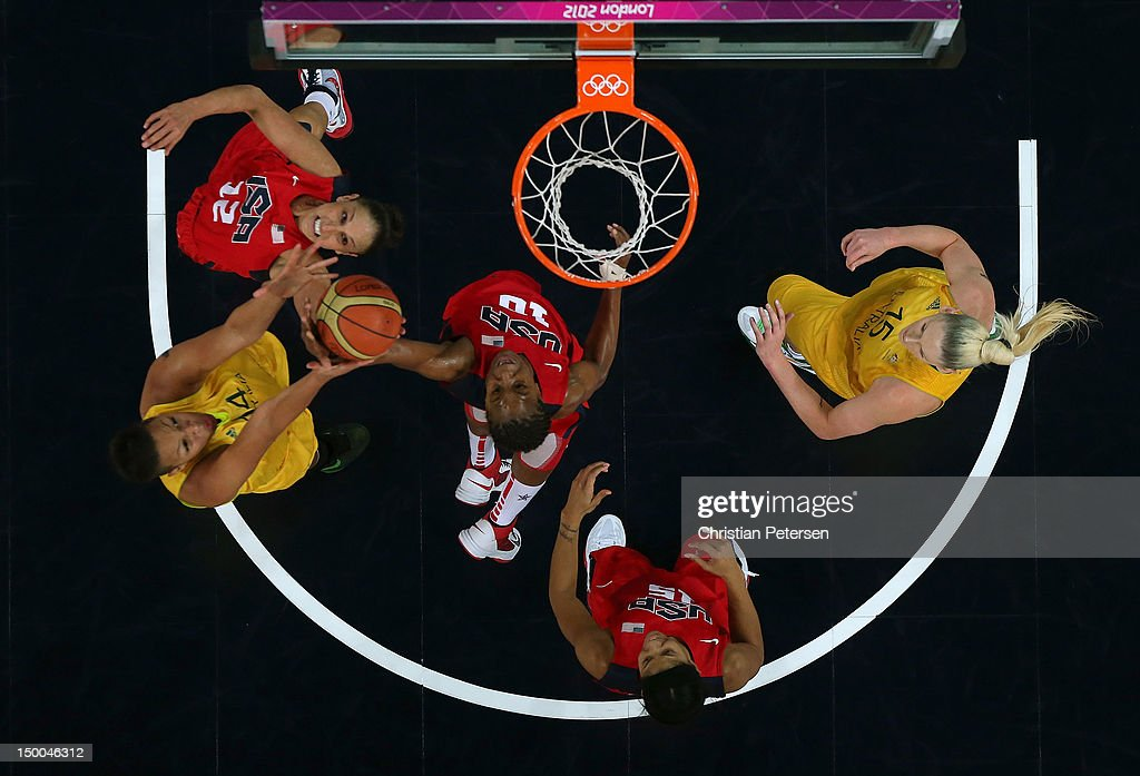Diana Taurasi #12, Tamika Catchings #10 (C) and Candace Parker #15 of United States look to control the ball against Liz Cambage #14 (L) and Lauren Jackson #15 (R) of Australia during the Women's Basketball semifinal on Day 13 of the London 2012 Olympics Games at North Greenwich Arena on August 9, 2012 in London, England.