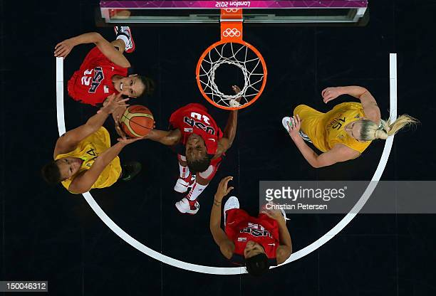 Diana Taurasi Tamika Catchings and Candace Parker of United States look to control the ball against Liz Cambage and Lauren Jackson of Australia...