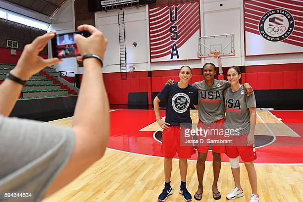 Diana Taurasi Tamika Catchings and Sue BIrd of the USA Basketball Women's National Team pose for a photo after practice during the Rio 2016 Olympic...