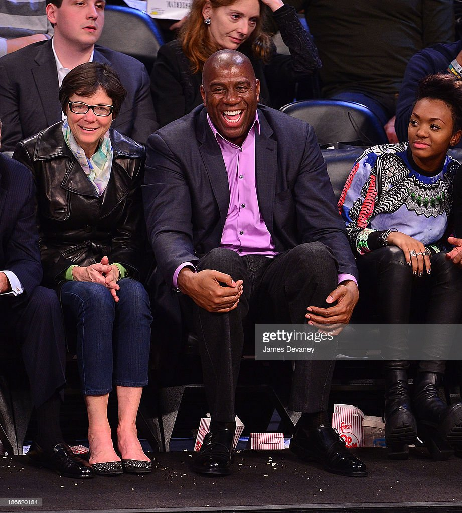 Diana Taylor, <a gi-track='captionPersonalityLinkClicked' href=/galleries/search?phrase=Magic+Johnson&family=editorial&specificpeople=157511 ng-click='$event.stopPropagation()'>Magic Johnson</a> and daughter Elisa attend the Miami Heat vs Brooklyn Nets game at Barclays Center on November 1, 2013 in the Brooklyn borough of New York City.