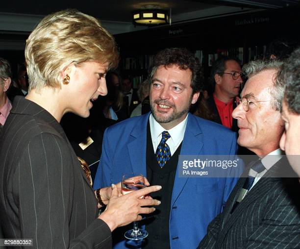 Diana The Princess of Wales talking to TV presenter Jeremy Beadle and photographer to the stars Terry O'Neill at Harrods book department today where...