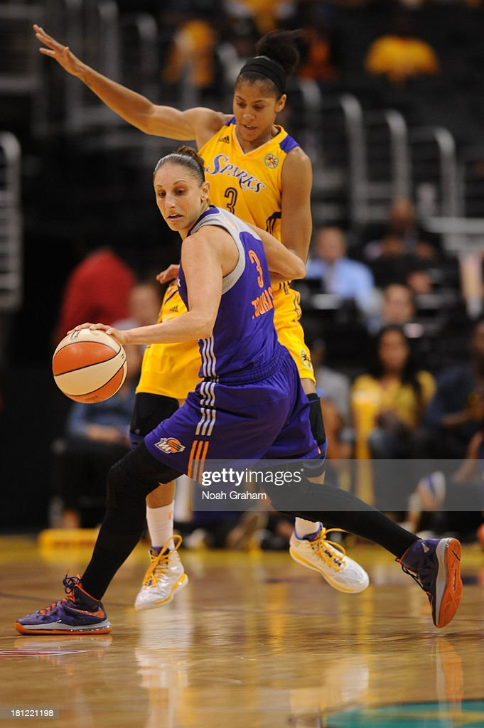 Diana Turasi #3 of the Phoenix Mercury handles the basketball while being guarded by <a gi-track='captionPersonalityLinkClicked' href=/galleries/search?phrase=Candace+Parker&family=editorial&specificpeople=752955 ng-click='$event.stopPropagation()'>Candace Parker</a> #3 of the Los Angeles Sparks at STAPLES Center on September 19, 2013 in Los Angeles, California.