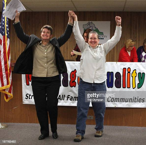 Diana Wickman left and JP Persall of Sequim celebrate after receiving their marriage license during ceremonies at the Thurston County Courthouse...