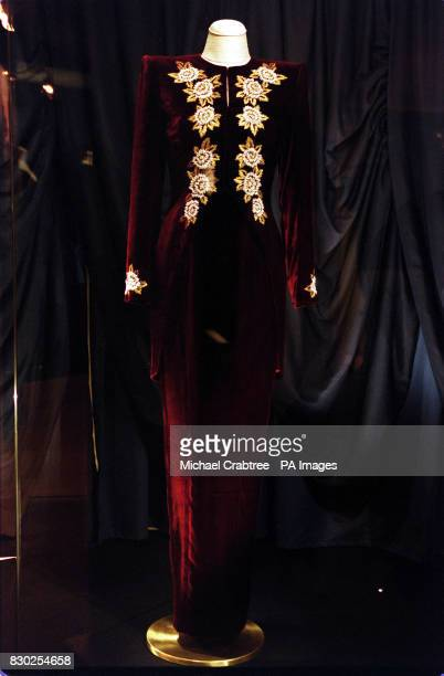 Diana's Dresses A burgundy dress and tail coat created by designer Catherine Walker in 1990 worn by Diana Princess of Wales to the premiere of the...