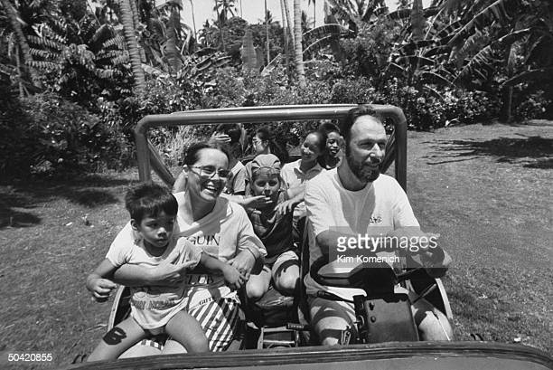 Diane and Tom Palmeri Americans doing charity work in Philippines driving jeep w natural daughter Erlinda and adopted Philippine children Edmund...