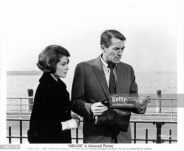 Diane Baker tries to help amnesia victim Gregory Peck clear his memory in a scene from the film 'Mirage' 1965