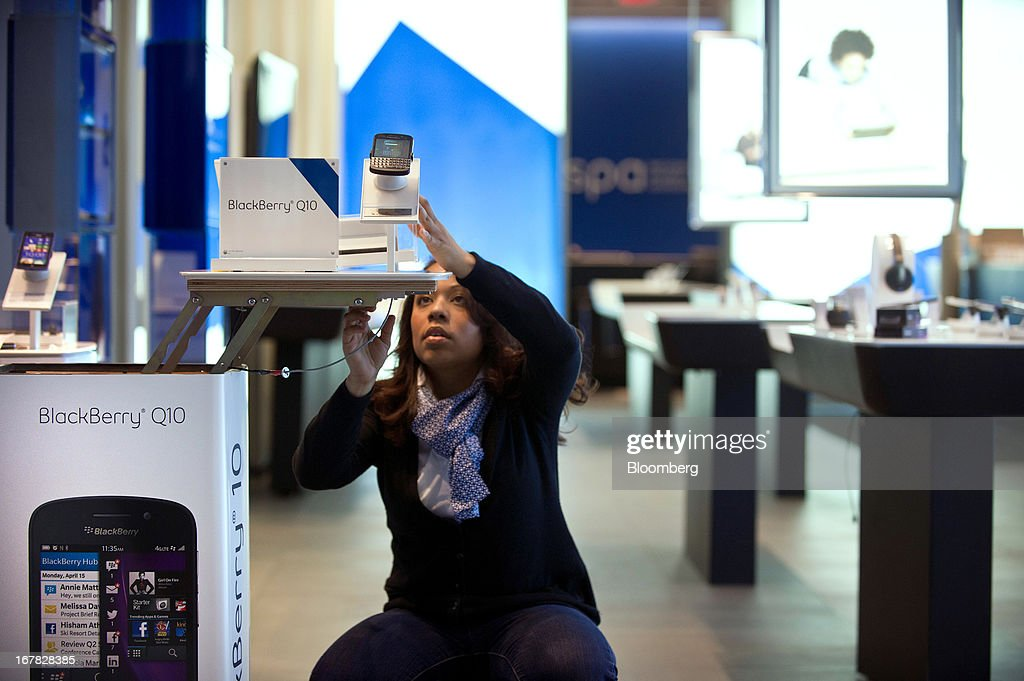 Diane Baxter, corporate store manager, prepares a BlackBerry Q10 display at a Bell Canada retail location in Toronto, Canada, on Tuesday, April 30, 2013. BlackBerry, the Canadian smartphone maker, climbed to its highest level in more than a month after Chief Executive Officer Thorsten Heins said he sees sales of its new Q10 device to be in the 'tens of millions.' Photographer: Galit Rodan/Bloomberg via Getty Images