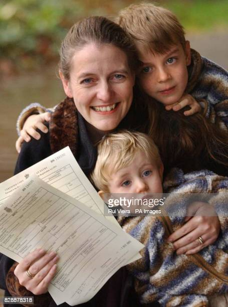 Diane Blood with sons Liam four and Joel 16months shows birth certificates bearing the name of their father outside Sheffield District Register...