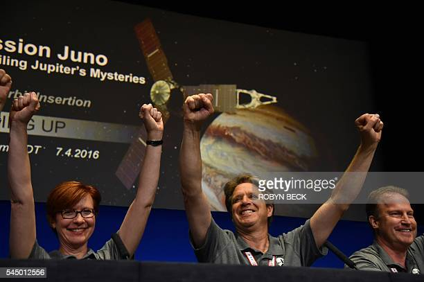 Diane Brown NASA Juno program executive Scott Bolton Juno principal investigator and Rick Nybakken Juno project manager celebrate at a press...