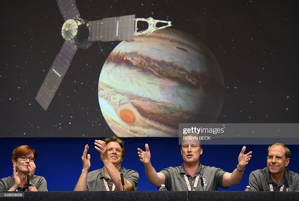TOPSHOT - (From L) Diane Brown, NASA Juno program executive, Scott Bolton, Juno principal investigator, Juno Project manager Rick Nybakken and Guy Beutelschies, Lockheed Martin director of space exploration, celebrate at a press conference after the Juno spacecraft was successfully placed into Jupiter's orbit, at the Jet Propulsion Laboratory in Pasadena, California on July 4, 2016. Juno was launched from Cape Canaveral in Florida on August 5, 2011 on a five-year voyage to its mission to study the planet's formation, evolution and structure. / AFP / Robyn BECK