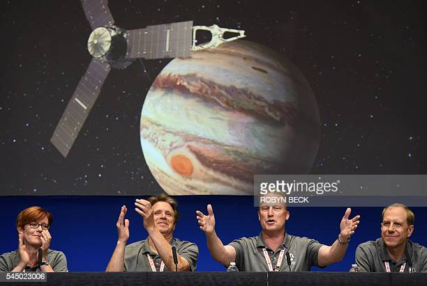 TOPSHOT Diane Brown NASA Juno program executive Scott Bolton Juno principal investigator Juno Project manager Rick Nybakken and Guy Beutelschies...