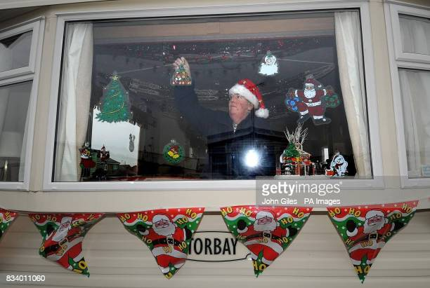 Diane Cooper puts up decorations in her caravan at Toll Bar near Doncaster where she and her family will be celebrating Christmas after her home was...