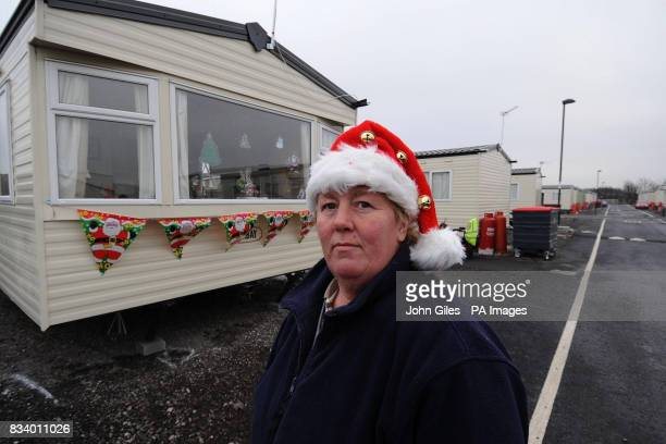 Diane Cooper stands outside her caravan at Toll Bar near Doncaster where she and her family will be celebrating Christmas after her home was flooded...