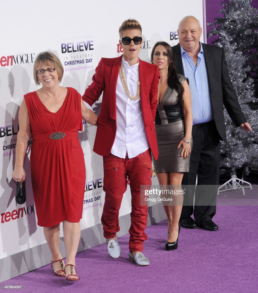 Diane Dale, singer/producer Justin Bieber, Pattie Mallette and Bruce Dale arrive at the world premiere of 'Justin Bieber's Believe' at Regal Cinemas L.A. Live on December 18, 2013 in Los Angeles, California.