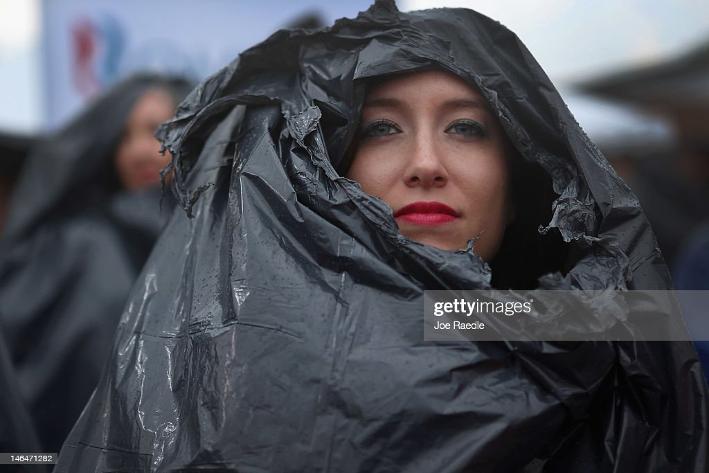 Diane Ferritto wears a garbage bag to stay dry as she waits for the arrival of Republican Presidential candidate, former Massachusetts Governor Mitt Romney during a pancake breakfast campaign stop at Mapleside Farms on June 17, 2012 in Brunswick, Ohio. Romney is on a campaign swing through battleground states.