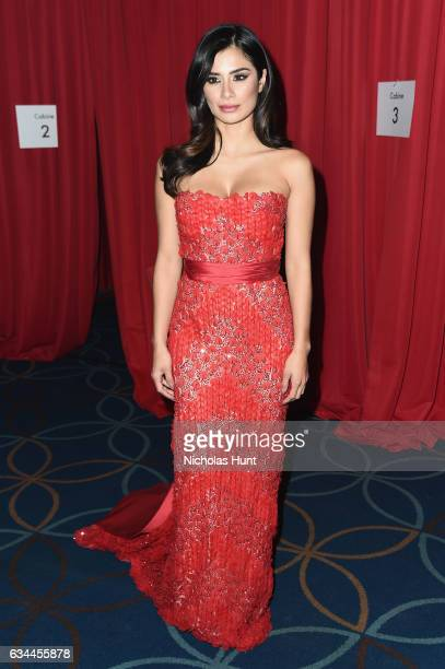 Diane Guerrero prepares backstage at the American Heart Association's Go Red For Women Red Dress Collection 2017 presented by Macy's at Fashion Week...